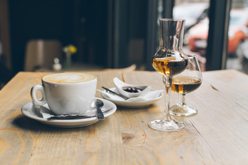 Coffee and brandy on a wooden table