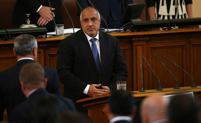 Bulgaria's new PM Borisov looks at members of his cabinet before taking an oath during a swearing-in ceremony in the parliament in Sofia