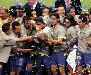 America's players celebrate with the Mexican league championship trophy after winning the final ...