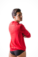 A young man with red wool sweater and underwear, back view, arms crossed on chest. Isolated on white background