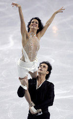 Canada's Marie-France Dubreuil and Patrice Lauzon perform at the World Figure Skating Championships in Calgary