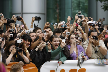 """Fans take photographs at the gala screening of """"The Men Who Stare at Goats"""" at Roy Thomson Hall during the 34th Toronto International Film Festival"""