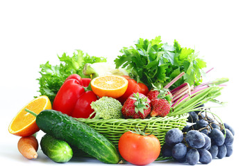 Organic fruits and vegetables in a basket on a white background