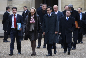 France's Junior Minister for Minister of the Interior Estrosi, Interior Minister Alliot-Marie, Prime Minister Fillon and Labour Minister Bertrand arrive in Elysee Palace