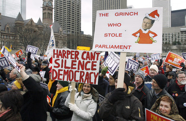 Pro-coalition government supporters listen to speeches during a rally at Nathan Phillips Square in Toronto