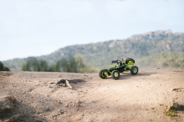 Radio-controlled car on the sand. Close up