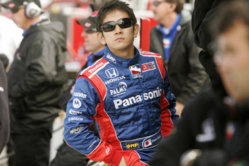 Hideki Mutoh of Japan watches practice on Pole Day at the Indianapolis Motor Speedway