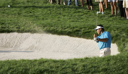 """Choi chips out of the sand on the 18th hole during the first round of """"The Barclays"""" in New York"""