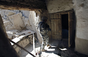 SFC Partin checks a house during a joint foot patrol in Logar province
