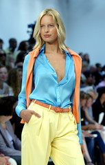 A model wears yellow slacks, sky blue blouse and orange sweater during the presentation of the Ralph..
