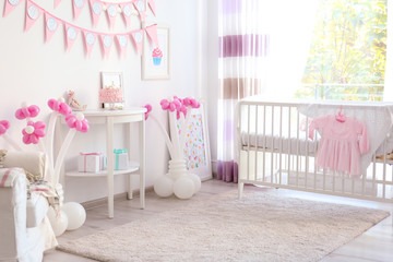 Interior of child's room decorated for birthday celebration