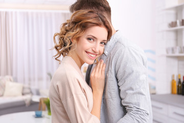 Cute happy young couple at home