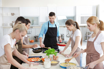 Canvas Prints Cooking Male chef and group of people at cooking classes