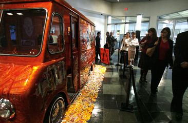 Visitors walk by a 1953 Chevrolet ice cream truck on display at Petersen Automotive museum in Los Angeles
