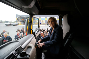 Marine Le Pen, French National Front (FN) party candidate for 2017 presidential election, sits on a truck during a campaign visit in Dol-de-Bretagne