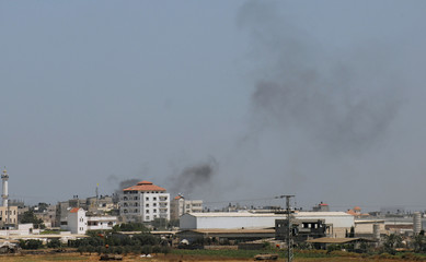 Smoke rises from Gaza as seen from Israel's Karni Crossing