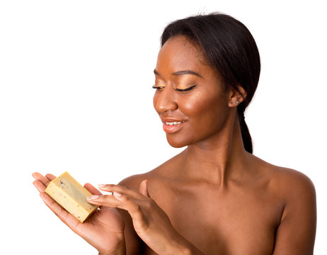 beautiful african american woman holding soap