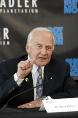 Astronaut Aldrin speaks to the media as he reunites with fellow astronaut Lovell in Chicago