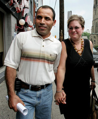 Mohamed Harkat walks with his wife following a press conference in Ottawa