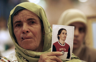 Palestinian woman, who is a Hamas supporter, holds up a picture of a jailed relative during a demonstration in Ramallah