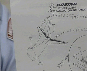 A video grab shows Eddy Suyanto, the air base commander in Makassar, holding up an illustration showing the tail of a Boeing 737 airplane in Makassar