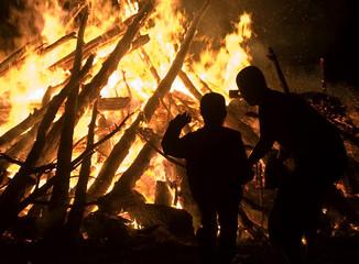 People watch a bonfire during San Juan night in Burgos