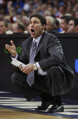 Wake Forest head coach Dino Gaudio gives his players instructions against the University of Maryland during the second round of the ACC college basketball tournament at the Georgia Dome in Atlanta