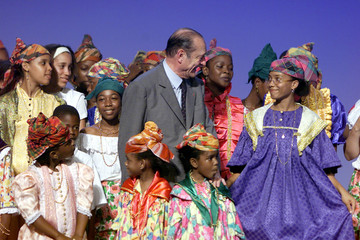 French President Jacques Chirac (C) poses among traditionaly dressed supporters at the end of an ele..