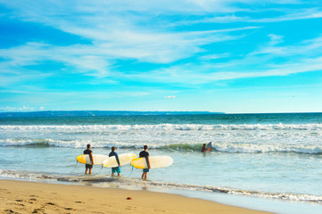 Surfers going to surf