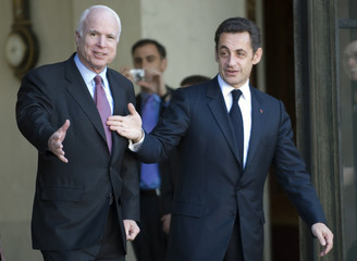 France's President Sarkozy walks with U.S. Republican presidential candidate Senator McCain following a meeting at the Elysee Palace