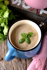 Chicken cream soup with cheese in mug.