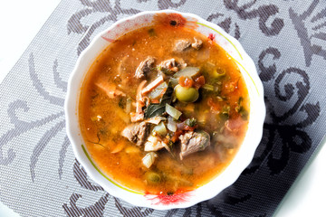 Traditional Russian soup solyanka closeup, view from above