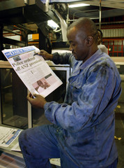 A PRINTER OF THE INDEPENDENT ZIMBABWE NEWSPAPER THE DAILY NEWS CHECKS THE FRONT PAGE DURING THE ...