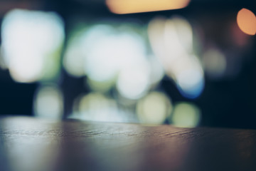 Wooden table in cafe with blur bokeh abstract vintage background
