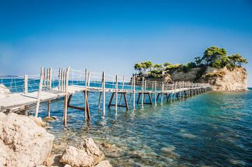 Greece, Zakynthos, wooden Bridge to the small island Agios Sostris, to the cliffs