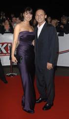 "British actress Barton and actor Fenwick pose at the ""National Television Awards"" at the Royal Albert Hall in London"
