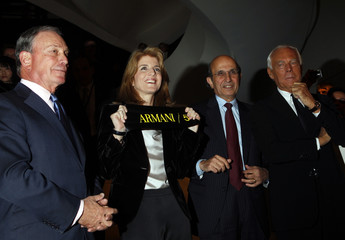 New York Mayor Michael Bloomberg, Caroline Kennedy, New York City Schools Chancellor Joel Klein and Giorgio Armani cut a ribbon during the opening of the Armani store on 5th Avenue in New York