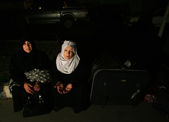 Palestinian pilgrims wait to leave Gaza through the Rafah border between Gaza and Egypt