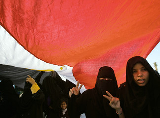 Egyptian women protest against bomb attack in Red Sea resort of Dahab