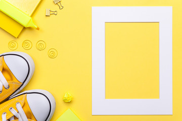 School Accessories with White Frame on Yellow Background