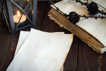 made old sheets of paper, books and candle