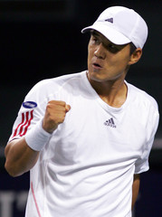 South Korea's Lee reacts after getting point against Spain's Robredo at Japan Open tennis championships in Tokyo