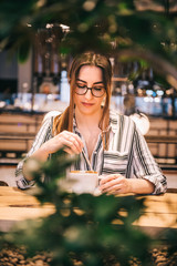 Woman with eyeglasses drinking coffee