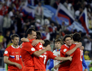 Russia's team celebrates after their Euro 2008 soccer match victory over Sweden in Innsbruck
