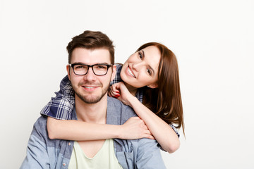 Happy casual couple posing to camera, isolated