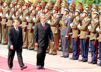 East Timor's President Gusmao and Vietnamese counter-part Luong review honour guards in Hanoi.