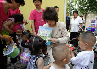 US LABOUR SECRETARY ELAINE CHAO HOLDS CHILDREN'S BOOK DURING A VISIT TO LANGFANG CHILDREN'S VILLAGE ...