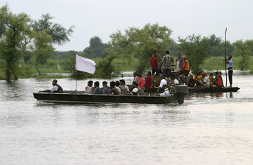 Indian soldiers evacuate flood-affected people to safer places at Jamunghat village