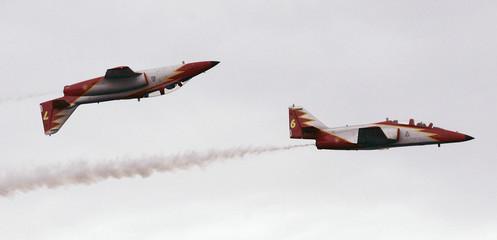Members of the Spanish Air Force aerobatic group 'Patrulla Aguila' fly over Samil beach in Vigo
