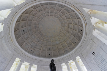 Classically styled domed roof interior of the historic Thomas Jefferson Memorial including the bronze statue of Jefferson, West Potomac Park, Washington DC